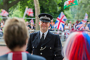 Security was tight but good humoured - Queens 90th birthday was celebrated by the traditional Trooping the Colour as well as a flotilla on the river Thames.