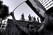 protestor with flag outside the Shura Coucil, July 12th 2011Thousands of Egyptians protest in Cairo's Tahrir square and march on government buildings calling for the ruling military council to fulfil its promises after the ousting of Hosni Mubarak on January 25th
