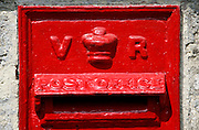 Wall Mounted Post-Box showing the cipher VR for the reign of Queen Victoria