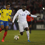 Jozy Altidore, (right), USA, challenged by Luis Canga, Ecuador, during the USA Vs Ecuador International match at Rentschler Field, Hartford, Connecticut. USA. 10th October 2014. Photo Tim Clayton