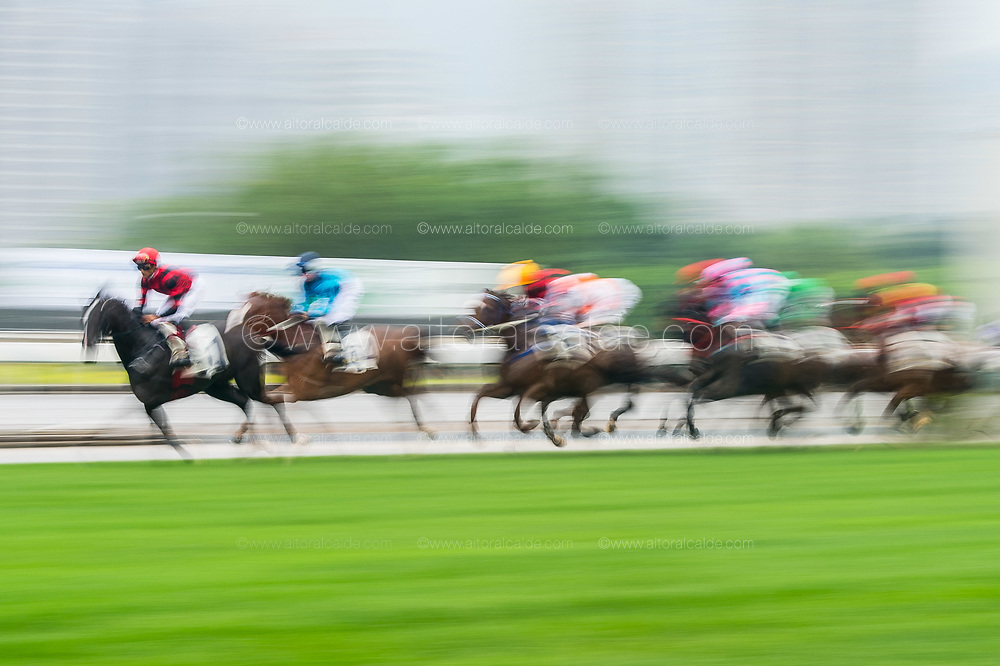 HONG KONG - MAY 04:  Riders compete during The Queen Mother Memorial Cup at Sha Tin racecourse on May 4, 2014 in Hong Kong, Hong Kong.  (Photo by Aitor Alcalde/Getty Images)