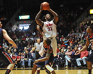 """Ole Miss' Murphy Holloway (31) grabs a rebound over Auburn guard Josh Wallace (11) and scores at the C.M. """"Tad"""" Smith Coliseum on Saturday, February 23, 2013.  (AP Photo/Oxford Eagle, Bruce Newman)"""