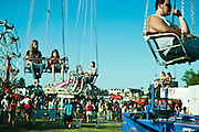 Lathan Goumas for the Midland Daily News..People ride the swings at the carnival in Veterans Park in Bay City, Mich. during final day of the 50th Bay City Fireworks Festival on Saturday, July 7, 2012. In celebration the festival planned to fire off 50,000 fireworks in 50 minutes on the final day of the three day event.