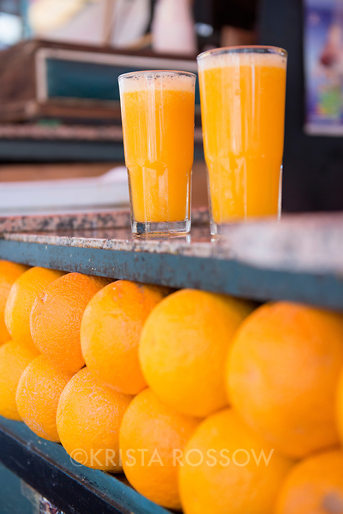 Fresh squeezed orange juice and oranges at a stall in Jemaa el-Fnaa, the main marketplace square in the Medina of Marrakesh, Morocco.