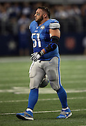 Detroit Lions center Dominic Raiola (51) comes off the field with his helmet off during the NFL week 18 NFC Wild Card postseason football game against the Dallas Cowboys on Sunday, Jan. 4, 2015 in Arlington, Texas. The Cowboys won the game 24-20. ©Paul Anthony Spinelli