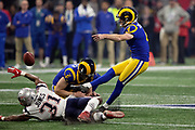 New England Patriots defensive back Jonathan Jones (31) dives while attempting a block and Los Angeles Rams punter Johnny Hekker (6) holds while Rams kicker Greg Zuerlein (4) kicks a 53 yard field goal that ties the third quarter score at 3-3 during the NFL Super Bowl 53 football game Sunday, Feb. 3, 2019, in Atlanta. The Patriots defeated the Rams 13-3. (©Paul Anthony Spinelli)