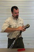 Timber Rattlesnake (Crotalus horridus) - Black morph<br /> & Chris Jenkins taking data<br /> Northern Georgia<br /> USA<br /> HABITAT & RANGE: Deciduous forests in rugged terrain and open, rocky ledges. Eastern USA