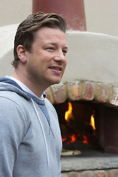 © Licensed to London News Pictures. 20/05/2013. London, England. Pictured: Celebrity Chef Jamie Oliver baking bread. Celebrities at Press Day Monday of the RHS Chelsea Flower Show. Photo credit: Bettina Strenske/LNP