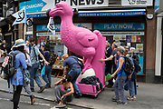 "A pink Dodo is pushed through London streets en-route to where other environmental and climate change protesters block Fleet Street on the first day of a week-long country-wide protests using using five boats to stop traffic in Cardiff, Glasgow, Bristol, Leeds, and London, on 15th July 2019, in London, England. The group is calling on the government to declare a climate emergency, saying it was beginning a five-day ""summer uprising"" and that 'Ecocide' ought to be a criminal offence in law."