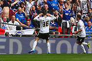 Josh McQuoid of Peterborough United celebrates scoring the opening goal during the Johnstone's Paint Trophy Final match at Wembley Stadium, London<br /> Picture by David Horn/Focus Images Ltd +44 7545 970036<br /> 30/03/2014