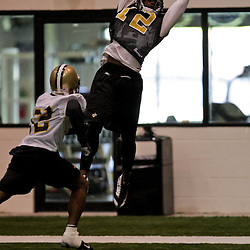 18 June 2009: Saints wide receiver Marques Colston (12) goes up for a catch over the coverage of cornerback Jabari Greer (32) during the New Orleans Saints Organized Team Activities held at the team's indoor practice facility in Metairie, Louisiana.