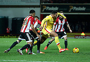 Milton Keynes Dons midfielder Daniel Powell surrounded by Brentford players during the Sky Bet Championship match between Brentford and Milton Keynes Dons at Griffin Park, London, England on 5 December 2015. Photo by Matthew Redman.