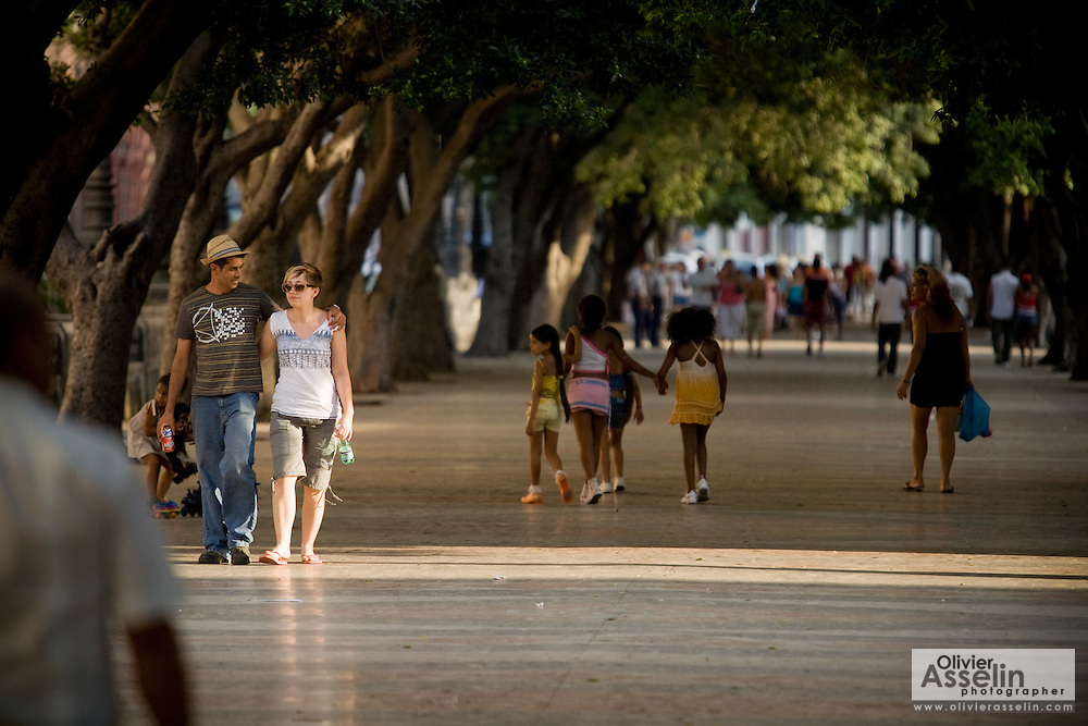 People walking along the Prado avenue in Havana, Cuba on Sunday June 29, 2008.