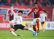 GUANGZHOU, CHINA - MARCH 16:  Muto Yuki of Urawa Red Diamonds (L) competes for the ball with Bezerra Maciel Junior (Paulinho) of Guangzhou Evergrande (R) during the AFC CHampions League match between Guangzhou Evergrande and Urawa Red Diamonds on March 16, 2016 in Guangzhou, China.  (Photo by Aitor Alcalde Colomer/Getty Images)