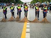 22 OCTOBER 2016 - BANGKOK, THAILAND: Bangkok city workers clean the streets around Sanam Luang Satursday before mourners arrived. Sanam Luang, the Royal Ceremonial Ground, was packed Saturday with more than 100,000 people mourning the Monarch's death. The King died Oct. 13, 2016. He was 88. His death came after a period of failing health. Bhumibol Adulyadej was born in Cambridge, MA, on 5 December 1927. He was the ninth monarch of Thailand from the Chakri Dynasty and is also known as Rama IX. He became King on June 9, 1946 and served as King of Thailand for 70 years, 126 days. He was, at the time of his death, the world's longest-serving head of state and the longest-reigning monarch in Thai history.       PHOTO BY JACK KURTZ