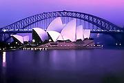 Sydney Opera house and bay bridge at dawn in Sydney, Australia