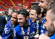 Bournemouth players pose with the Sky Bet Championship trophy during the Sky Bet Championship match between Charlton Athletic and Bournemouth at The Valley, London, England on 2 May 2015. Photo by David Charbit.