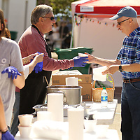 Tommy Green,left, serves up a bowl of soup to David Lesley at Chilifest Friday in downtown Tupelo
