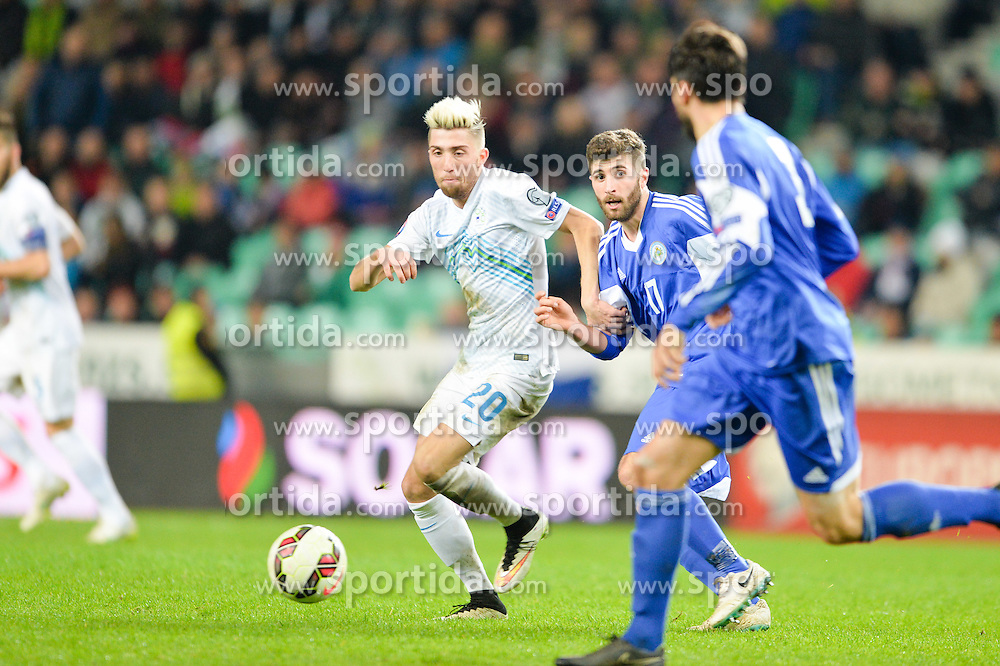 Kampl Kevin of Slovenia vs Golinucci Alessandro of San Marino during football match between NationalTeams of Slovenia and San Marino in Round 5 of EURO 2016 Qualifications, on March 27, 2015 in SRC Stozice, Ljubljana, Slovenia. Photo by Mario Horvat / Sportida