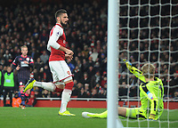 Football - 2017 / 2018 Premier League - Arsenal vs. Huddersfield Town<br /> <br /> Olivier Giroud of Arsenal scores goal no 2 past Huddersfield goalkeeper, Jonas Lossl at The Emirates.<br /> <br /> COLORSPORT/ANDREW COWIE