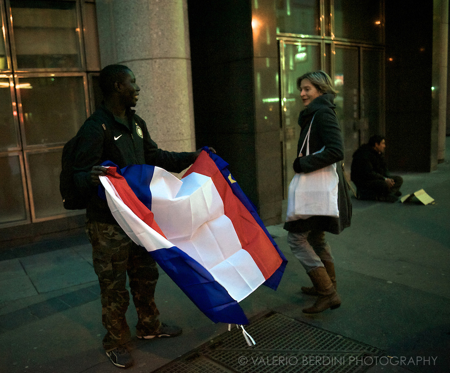 French flags are being sold in the surrounding of the place.