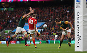 Wales Dan Biggar just about clearing the lines and replelling another attack during the Rugby World Cup Quarter Final match between South Africa and Wales at Twickenham, Richmond, United Kingdom on 17 October 2015. Photo by Matthew Redman.