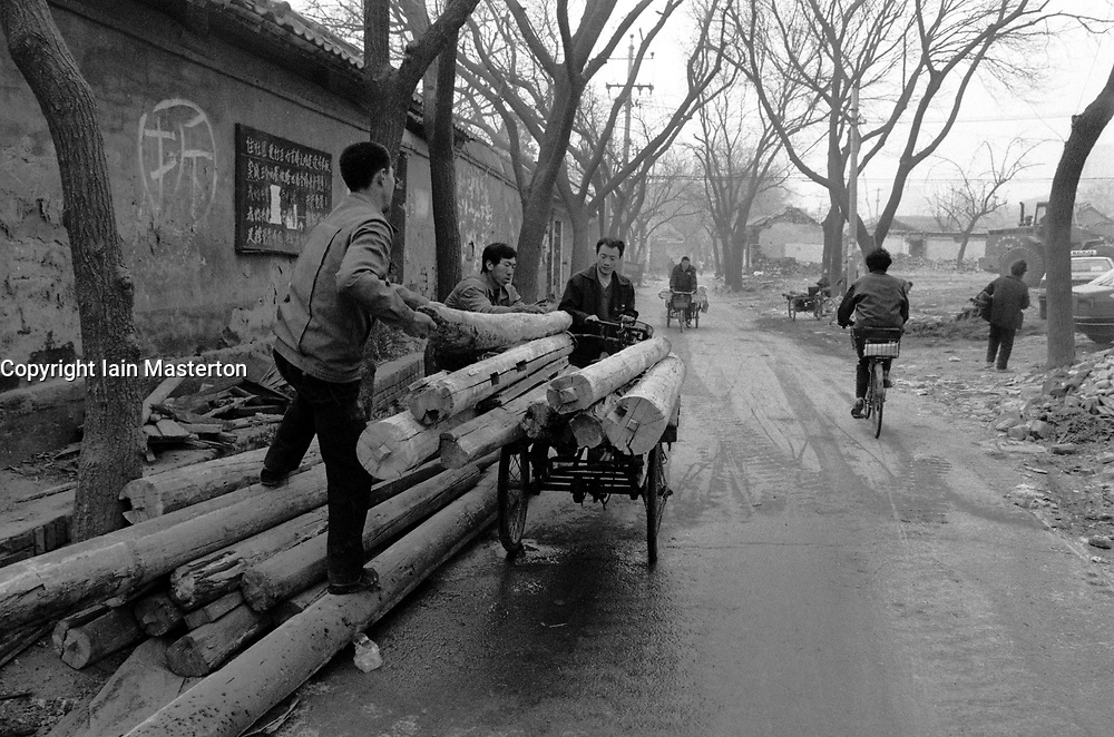 Timber from demolished houses being recycled in a hutong in Beijing China