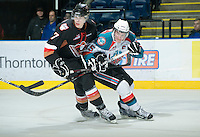 KELOWNA, CANADA, JANUARY 1: Colton Sissons #15 of the Kelowna Rockets checks Alex Roach #7 of the Calgary Hitmen as the Calgary Hitmen visit the Kelowna Rockets on January 1, 2012 at Prospera Place in Kelowna, British Columbia, Canada (Photo by Marissa Baecker/Getty Images) *** Local Caption ***