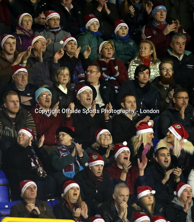 20 December 2014 Premeir League Football - Tottenham Hostpur v Burnley;  Burnley fans wearing Santa Claus hats.<br /> Photo: Mark Leech.
