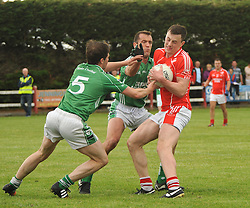 Ballintubber&rsquo;s Diarmuid O&rsquo;Connor gets held up by the Charlestown defence.<br /> Pic Conor McKeown