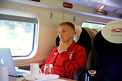 RUNCORN, ENGLAND - Tuesday, May 22, 2018: Wales' Matthew Smith travel by train as the squad heads to Heathrow for a flight to Los Angeles ahead of the international friendly match against Mexico. (Pic by David Rawcliffe/Propaganda)