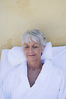 Senior woman in bathrobe at health spa