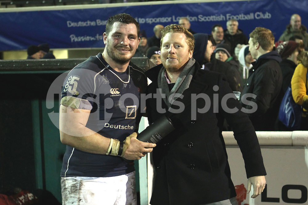 James Phillips collects his Man of the Match award during the Green King IPA Championship match between London Scottish &amp; Cornish Pirates at Richmond, Greater London on 16th January 2015<br /> <br /> Photo: Ken Sparks | UK Sports Pics Ltd<br /> London Scottish v Cornish Pirates, Green King IPA Championship, 16h January 2015<br /> <br /> &copy; UK Sports Pics Ltd. FA Accredited. Football League Licence No:  FL14/15/P5700.Football Conference Licence No: PCONF 051/14 Tel +44(0)7968 045353. email ken@uksportspics.co.uk, 7 Leslie Park Road, East Croydon, Surrey CR0 6TN. Credit UK Sports Pics Ltd