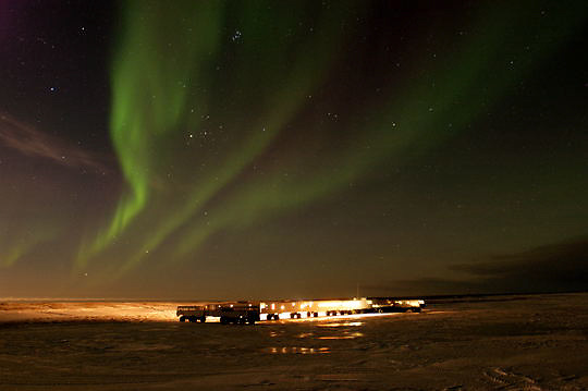 Aurora borealis, also known as Northern Lights dance above Tundra Buggy Lodge. Cape Churchill, Manitoba. Canada.