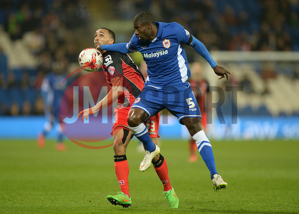 Cardiff City's Bruno Ecuele Manga battles for the ball with Bournemouth's Callum Wilson - Photo mandatory by-line: Alex James/JMP - Mobile: 07966 386802 - 17/03/2015 - SPORT - Football - Cardiff - Cardiff City Stadium - Cardiff City v AFC Bournemouth - Sky Bet Championship