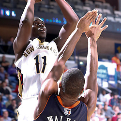 Nov 2, 2013; New Orleans, LA, USA; New Orleans Pelicans point guard Jrue Holiday (11) shoots over Charlotte Bobcats point guard Kemba Walker (15) during the first half of a game at New Orleans Arena. Mandatory Credit: Derick E. Hingle-USA TODAY Sports