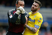 Birmingham City goalkeeper Lee Camp clutches the ball despite the attentions of Leeds United midfielder Stuart Dallas (15)  during the EFL Sky Bet Championship match between Birmingham City and Leeds United at St Andrews, Birmingham, England on 6 April 2019.
