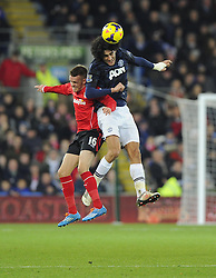 Man Utd Midfielder Marouane Fellaini (BEL) battles for the high ball with Cardiff City Midfielder, Craig Noone (ENG) - Photo mandatory by-line: Joseph Meredith/JMP - Tel: Mobile: 07966 386802 - 24/11/2013 - SPORT - FOOTBALL - Cardiff City Stadium - Cardiff City v Manchester United - Barclays Premier League.