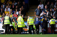 Hartlepool - Saturday August 29th, 2009: A Norwich City supporter has to receive emergency medical attention after falling over the railing while celebrating their opening goal during the Coca Cola League One match at Victoria Park, Hartlepool. (Pic by Jed Wee/Focus Images)..