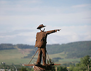 © 2008 Randy Vanderveen, all rights reserved.Dawson Creek, British Columbia.A statue of a surveyor marks the beginning (Mile 0) of the Alaska Highway in Dawson Creek, B.C..