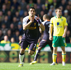 NORWICH, ENGLAND - Saturday, September 29, 2012: Liverpool's Luis Alberto Suarez Diaz celebrates scoring the first goal of his hat-trick against Norwich City during the Premiership match at Carrow Road. (Pic by David Rawcliffe/Propaganda)