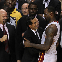 Jun 21, 2012; Miami, FL, USA; Miami Heat small forward LeBron James (6) hugs Miami Heat head coach Erik Spoelstra after winning the 2012 NBA championship at the American Airlines Arena. Miami won 121-106. Mandatory Credit: Derick E. Hingle-US PRESSWIRE