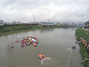 TAIPEI, CHINA - FEBRUARY 04: (CHINA OUT, TAIWAN OUT) <br /> <br /> TransAsia Airways Plane Crash<br /> <br /> The aerial photo shows rescue teams work to free people from a TransAsia Airways ATR 72-600 turboprop airplane that crashed into the Keelung River on February 4, 2015 in Taipei, Taiwan of China. The TransAsia Airways ATR 72-600 turboprop airplane crashed into the Keelung River shortly after taking off from Taipei Songshan airport on Wednesday. Over 50 people were onboard the aircraft when it clipped a bridge and crashed into the river. At least thirty one deaths have currently been reported and the injured have been sent to the nearest hospitals. The airplane was crashed when it took off in four minutes and the weather was suitable for flying that further possible causes were under investigation.<br /> ©Exclusivepix Media