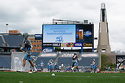 05/22/2014 - Foxboro, Mass. - The Tufts men's lacrosse team warms up on the field at Gillette Stadium for a special practice, hosted by Tufts trustee emeritus and lacrosse alumnus Dan Kraft, A87, in anticipation of the NCAA Division III National Championship on May 22, 2014. (Kelvin Ma/Tufts University)