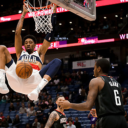 Mar 24, 2019; New Orleans, LA, USA; New Orleans Pelicans forward Christian Wood (35) dunks over Houston Rockets forward Gary Clark (6) during the second half at the Smoothie King Center. Mandatory Credit: Derick E. Hingle-USA TODAY Sports