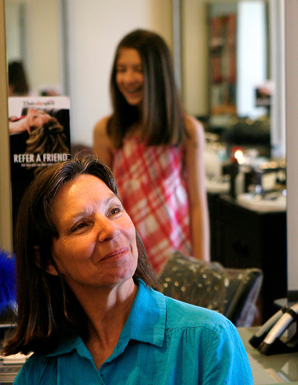 Dorothy Rothman looks at her daughter Hannah, 12, after she donated 10-inches of her hair to Locks of Love, a charity organization that makes wigs for cancer patients. Hannah donated her hair as a good deed for her upcoming bat mitzvah.