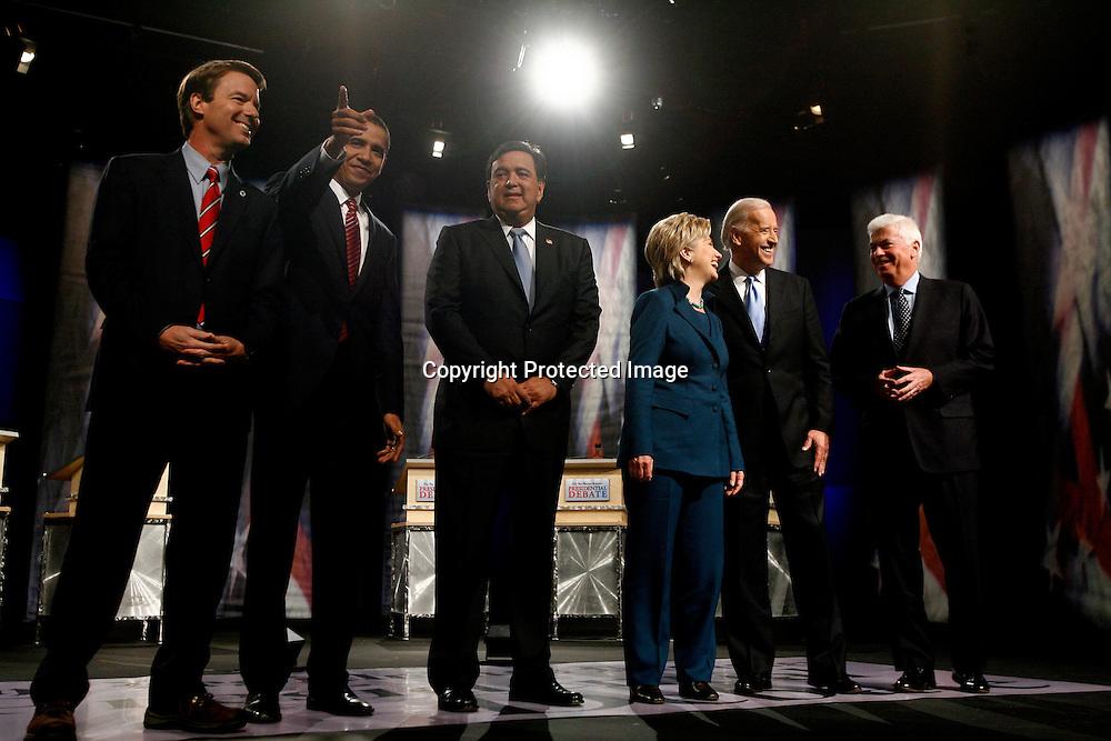 U.S. Democratic  Presidential candidates (L-R) former Senator John Edwards, Senator Barack Obama (D-IL), New Mexico Governor Bill Richardson, Senator Hillary Clinton (D-NY), Senator Joe Biden (D-DE), and Senator Chris Dodd (D-CT) take the stage during the Democratic Presidential debate in Johnston, Iowa December 13, 2007.