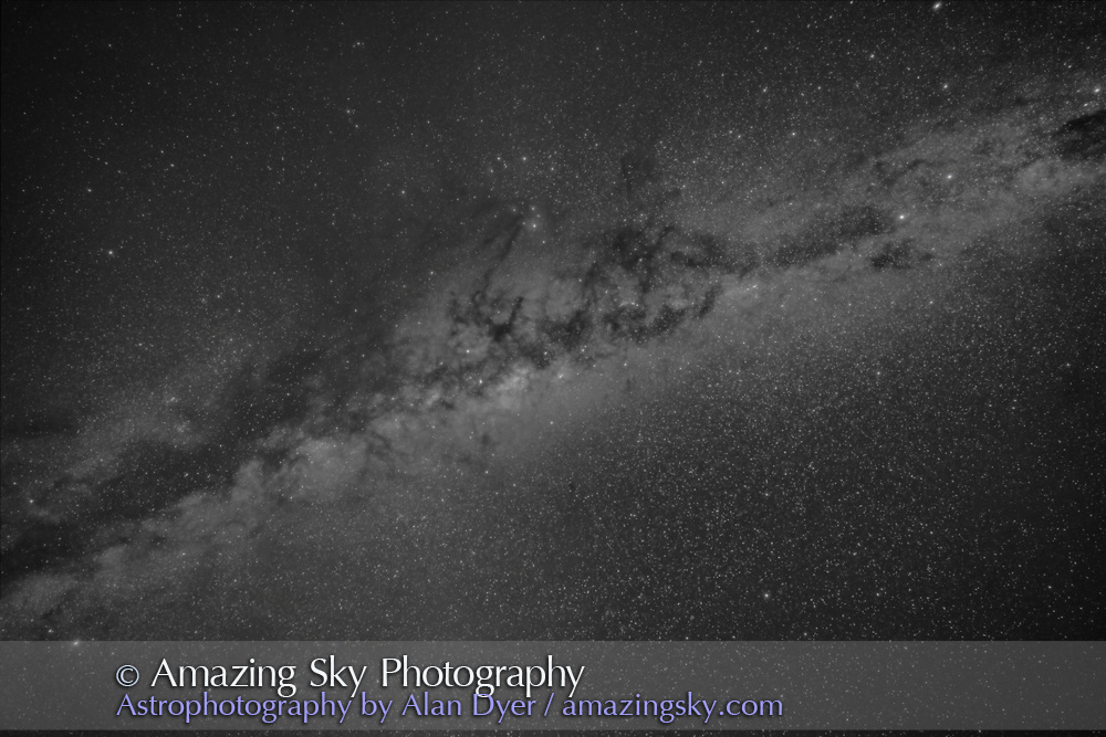 The centre of the Galaxy region in Sagittarius and Scorpius overhead in the wee hours of an April morning in Australia. At upper right are Alpha and Beta Centauri, while at lower left is Altair. <br /> <br /> The Norma Starcloud is right of the galactic core; the Scutum Starcloud is left of the core. Antares is the yellow star above centre, with the dark lanes of the Dark Horse and Pipe Nebula streaming up toward Antares area. <br /> <br /> Some airglow and Zodiacal Light tints the sky. <br /> <br /> This is a stack of 5 x 2.5-minute exposures with the 14mm Rokinon SP lens at f/2.8 and filter-modified Canon 5D Mark II at ISO 1600. On the iOptron Sky-Tracker, from Tibuc Gardens Cottage in Australia. This version of the image has been processed to make the view better resemble what you see with the unaided eye, in a largely monochrome and softer view than the colourful and high-contrast views commonly presented in astrophotos. Even at that there is more fine structure present in the Milky Way than the unaided eye usually sees, though binoculars beging to reveal that smaller detail. I have left some colours in some stars and in the foreground of landscape scenes.