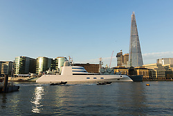 © Licensed to London News Pictures. 08/09/2016. LONDON, UK. Two polic rib boats pass a superyacht, known as 'Motor Yacht A' is seen moored next to HMS Belfast on the River Thames during the morning light. Motor Yacht A is owned by Russian billionaire, Andrey Melnichenko (known as the King of Bling). The stunning 390ft super yacht design is inspired by a submarine and was designed by Philippe Starck. It has been reported that Melnichenko is currently building a new super yacht and Motor Yacht A will be put up for sale.<br /> Photo credit: Vickie Flores/LNP