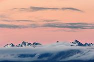 Gipfel im Goms zwischen Binntal und Nufenenpass mit Nebel, Wolken und einem roten Himmel nach Sonnenuntergang von der Riederalp aus gesehen, Wallis, Schweiz<br /> <br /> Peaks in the Goms area between Binntal and Nufenenpass with fog, clouds and a red sky after sunset seen from the Riederalp, Valais, Switzerland